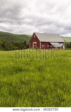 Farm landscape with red barn