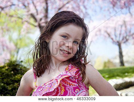 Happy Little Girl In A Park
