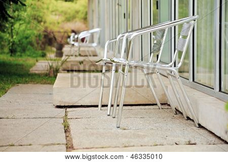 Alumina Folding Chairs On Garden Patios