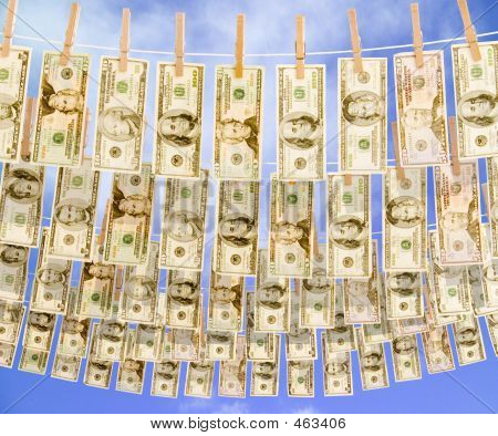 U.s. Currency Hanging On Multiple Clotheslines