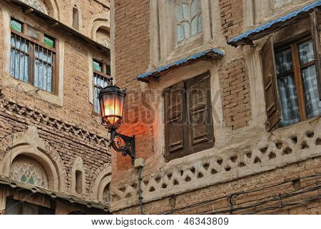 Yemen Sanaa. Lighting street torch on the ancien house in the old town poster