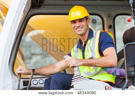 cheerful excavator operator on construction site