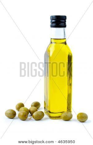 Bottle Of Olive Oil And Some Olives