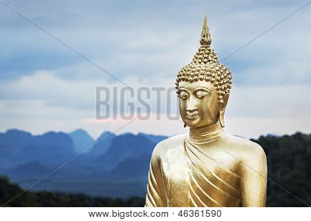 Golden Buddha statue on beauty sunset background poster