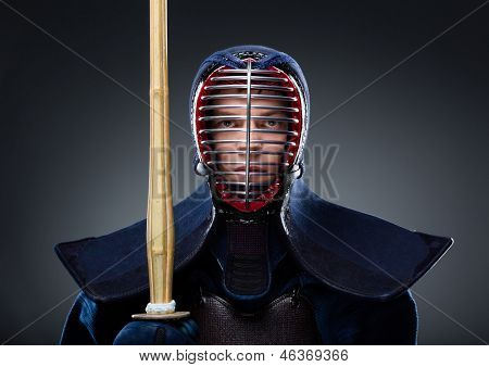 Portrait of kendo fighter with shinai. Japanese martial art of sword fighting