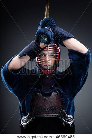 Portrait of kendoka with bokuto. Japanese martial art of sword fighting