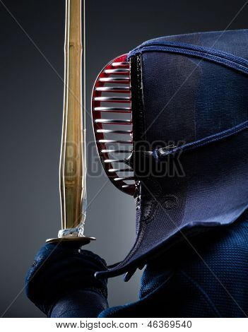 Profile of kendoka with bokuto. Japanese martial art of sword fighting