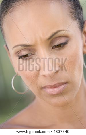 Head shot of woman scowling looking down poster