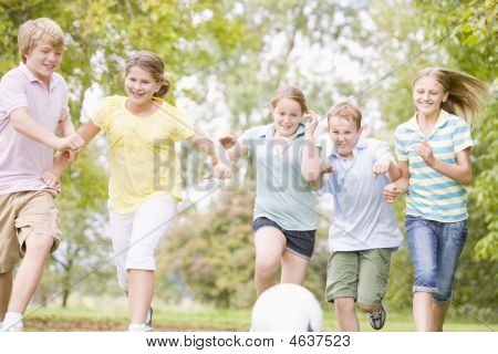 Five Young Friends Playing Soccer