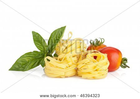 Italian colors food. Basil, pasta and tomatoes. Isolated on white background