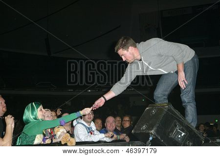 ANAHEIM, CA - MARCH 31: Stephen Amell greets fans after a panel discussion at the 2013 Wondercon convention on March 31, 2013 in Anaheim, CA.