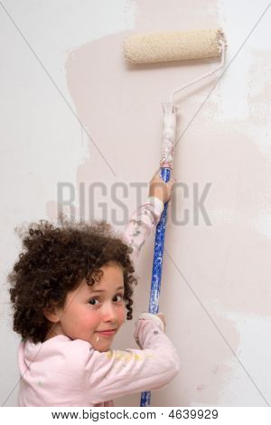 Girl Painting A Wall