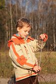 Boy in autumn wood with tape-line in hands poster