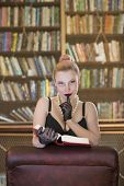 Beautiful caucasian woman being kinky in old library poster