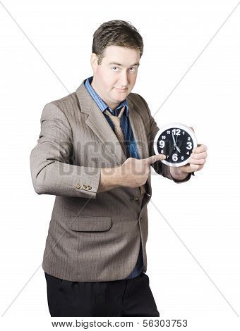 Business Person Pointing To Time On Office Clock