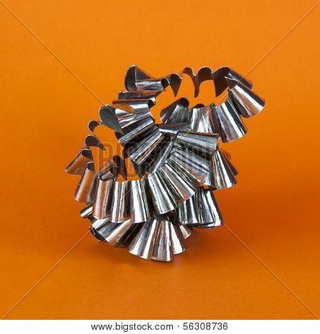 Metal Swarf On Orange Background