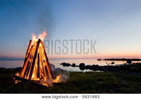 Bonfire And Sunset Sky