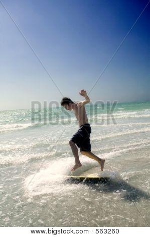 Teenage Boy Skim Boarding