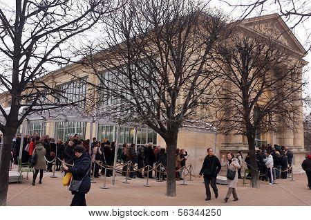 Visitors queue for an exhibition