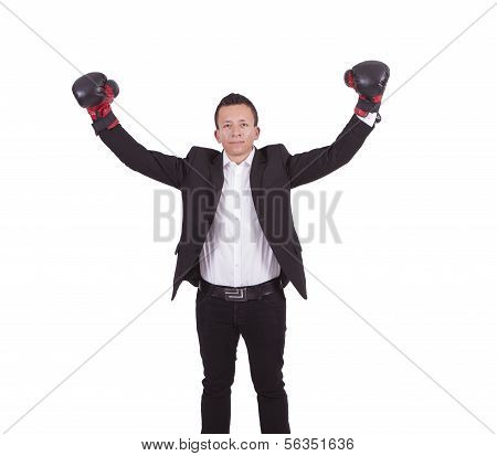 Young businessman with boxing gloves raising his arms