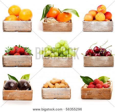 Set Of Orange, Tangerine, Apricot, Strawberry, Grape, Cherry, Nuts In The Wood Box. Isolated On Whit