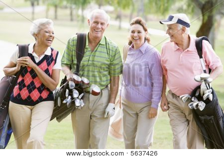 Portrait Of Four Friends Enjoying A Game Golf