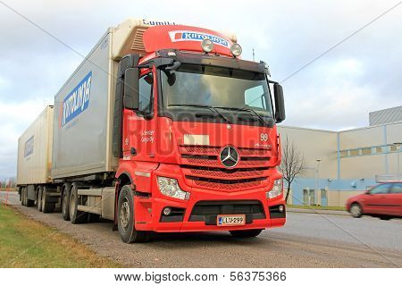 Red Mercedes-Benz Trailer Truck On The Road