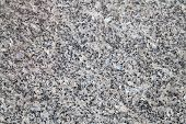 Natural gray granite stone closeup background texture poster