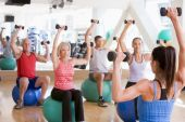 Instructor Taking Exercise Class At Gym poster
