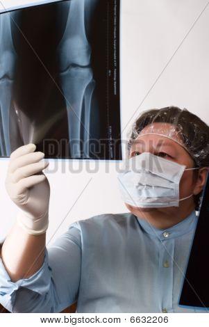 Mature Doctor Examining X-ray Image
