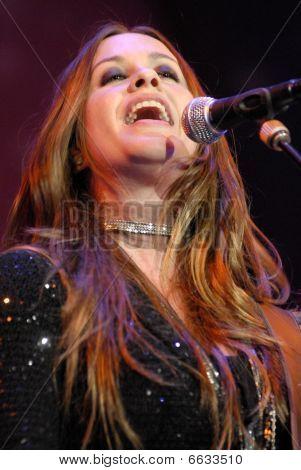 Alanis Morissette performing live.