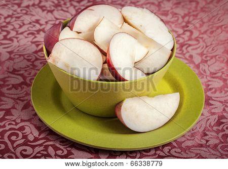Fresh sliced Cortland apples in a bowl.