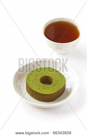 Maccha green tea baum cake and cup of tea
