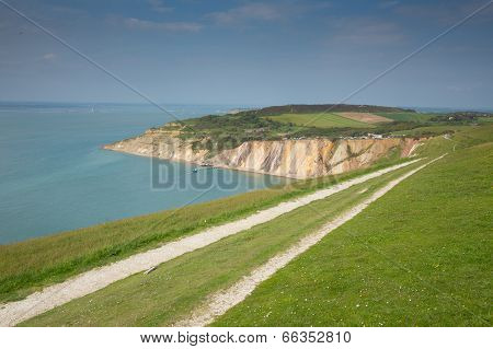 Coast path Alum Bay Isle of Wight beautiful beach and rocks next to the Needles tourist attraction