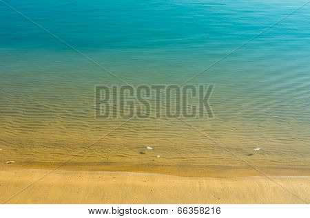 beautiful tropical blue green water and a  sand beach for background
