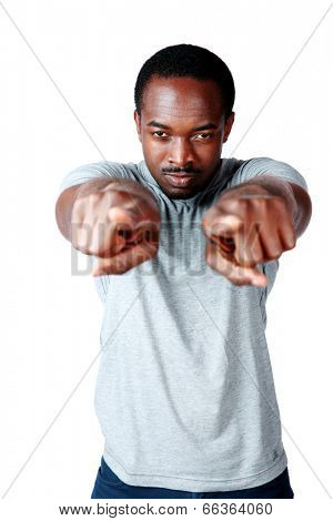 Handsome african man pointing at you over white background