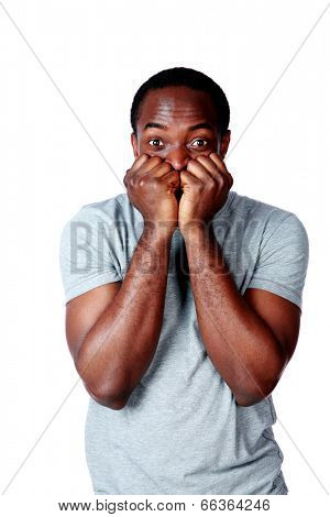 Portrait of a nerveous african man over white background