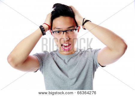 Portrait of a frightened young asian man over white background