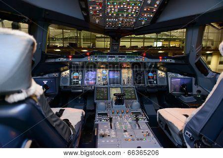Modern jet aircraft cockpit interior poster