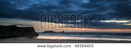 Landscape Panorama Rhosilli Bay Beach At Sunset With Moody Sky