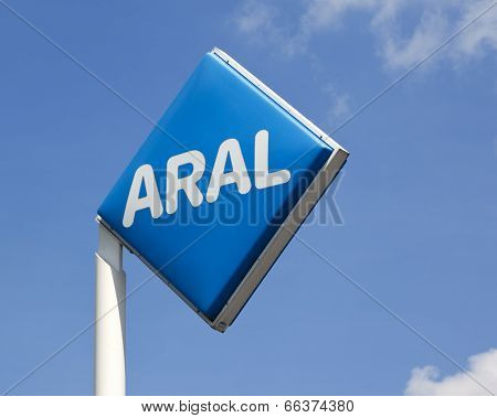 Hamburg, Germany - May 23, 2011: ARAL logo on post at a gas station against blue sky with small clouds. ARAL is a brand of BP p.l.c, the third largest energy company worldwide.