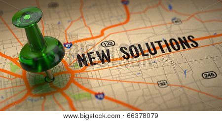 New Solutions - Green Pushpin on a Map Background.