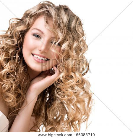 Beauty girl with blonde curly hair. Healthy and long Blond Wavy hair. Beautiful smiling young woman portrait. Beautiful face, natural make up