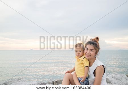 Asian Boy Pose On The Beach With His Mother