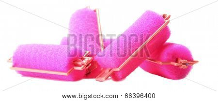 Pink hair curlers isolated on white
