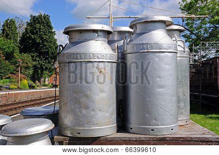 Old milk churns on railway platform, Hampton Loade.
