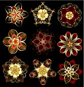 Set of abstract, jewelry, gold, stylized flowers on a black background. poster