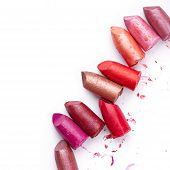 Broken Lipsticks isolated on white background. Cosmetic poster