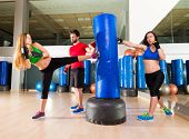 Boxing aerobox women group with personal trainer man at fitness gym poster