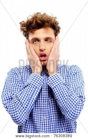 Portrait of a tired casual man over white background